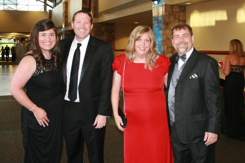 Lyndsey and Wes Ramey and Cheryl and Pete Owens mingled during the silent auction at the  25th annual Evening of Elegance.