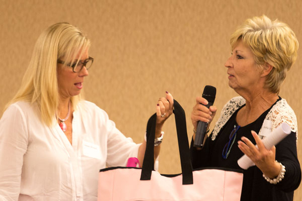 Comedian Leanne Morgan receives a bag of Paint the Mountains Pink swag from Debbie Dowling, executive director of the Dr. Robert F. Thomas Foundation, as thanks for entertaining the group of breast cancer survivors.