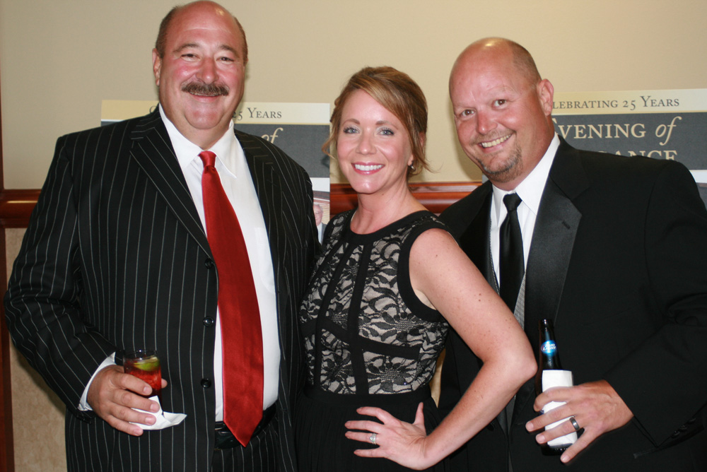 David Verble, Hope and Scooter Reagan enjoy last year's Evening of Elegance event at the Sevierville Convention Center.