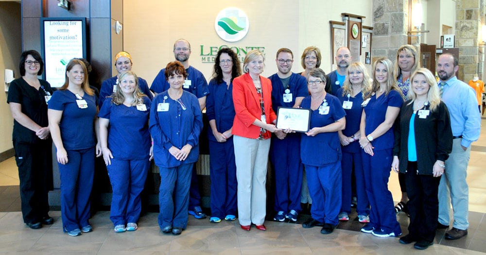 LeConte president Jenny Hanson presents outpatient staff with their PRC award.