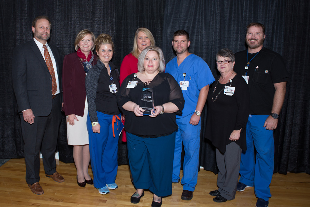 Covenant Health CEO Jim VanderSteeg is pictured with member of LeConte's Emergency Department Flow and Surge Capacity Initiative Team, including chief administrative officer Jenny Hanson, flow coordinator Callie West, chief nursing office Jennifer DeBow, emergency department manager Marci Clevenger, flow coordinator Abe McPherson, imaging manager Teresa Huskey, and emergency department supervisor Brenan Mitchell.