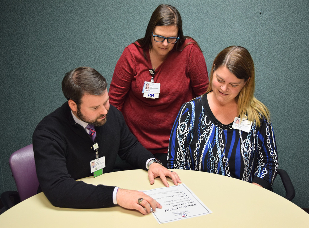 Michael Hatmaker, Holly White and Amy Miller review plans for the day.