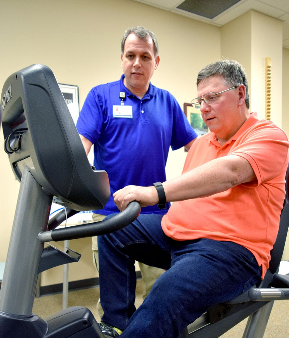 Exercise physiologist David Zerrlaut kept an eye on Ken Conner throughout his time in the cardiac rehabilitation program at LeConte Medical Center.