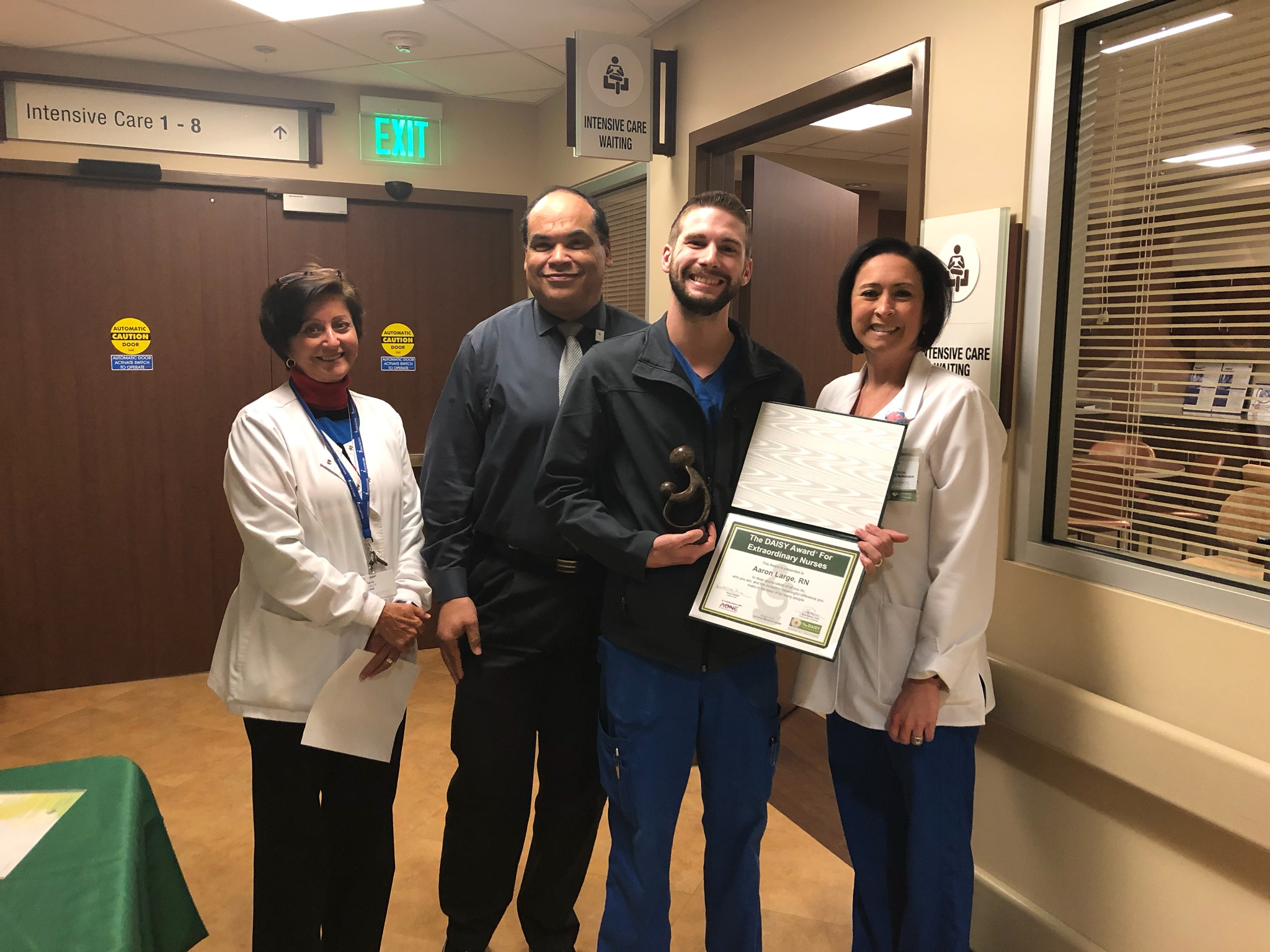 Aaron Large, RN, BSN, is presented the DAISY award for exceptional nursing.